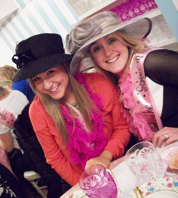 Hen girls wearing hats at Tea Party